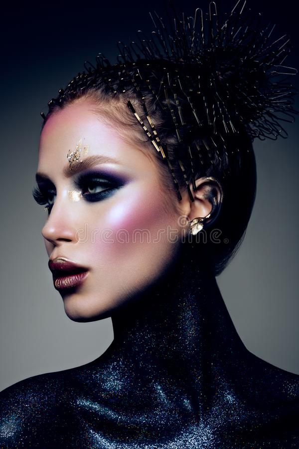 Fashion model with bright makeup and colorful glitter royalty free stock photography