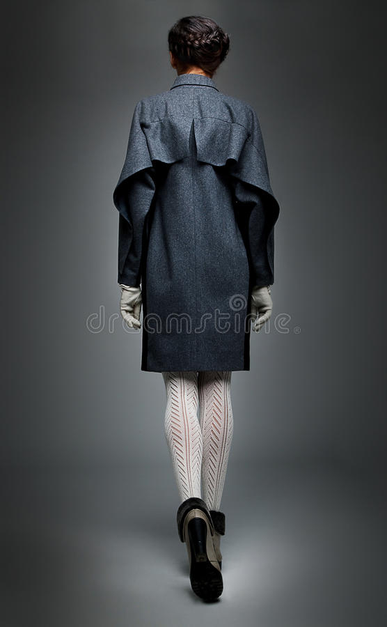 Download Fashion Model Brunette In Grey Coat Walking Away Stock Image - Image: 22480789