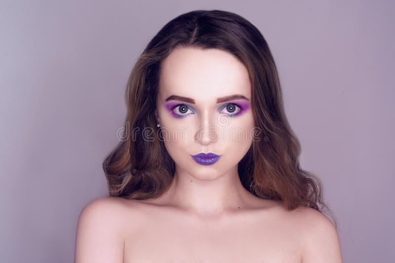 Fashion model with creative pink and blue make up.  Beauty art portrait of beautiful girl with colorful abstract makeup. Beautiful royalty free stock photo