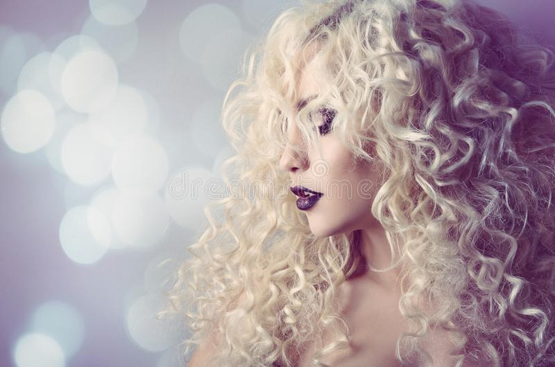 Fashion Model Curly Hair, Young Woman Beauty Portrait, Hairstyle Curls. Over Defocused Lights Background royalty free stock photos