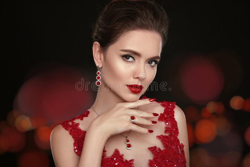 Fashion Model Diamond Jewelry. Beautiful young woman with makeup royalty free stock images