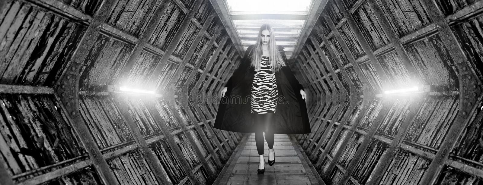 Fashion model doing the catwalk. In futuristic place royalty free stock photography