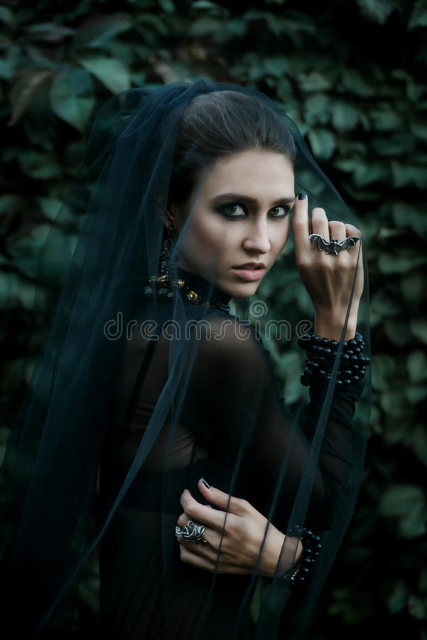 Fashion model dressed in gothic style. Vamp. royalty free stock photo