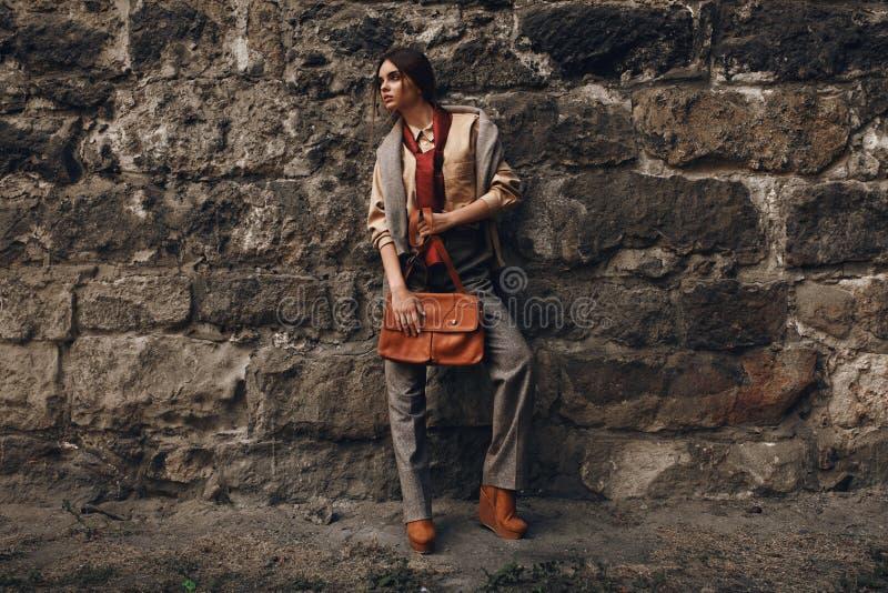 Fashion Model In Fashionable Clothes. Beautiful Woman Near Wall. Fashion Model In Fashionable Clothes. Beautiful Woman In Elegant Stylish Fall Clothes: Shirt stock photo