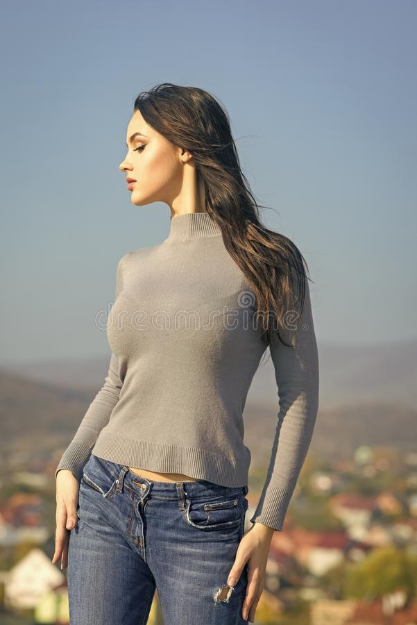 Fashion model with fit body pose in sweater jeans. On sunny day on natural landscape. Wanderlust, lifestyle, travelling, concept stock images