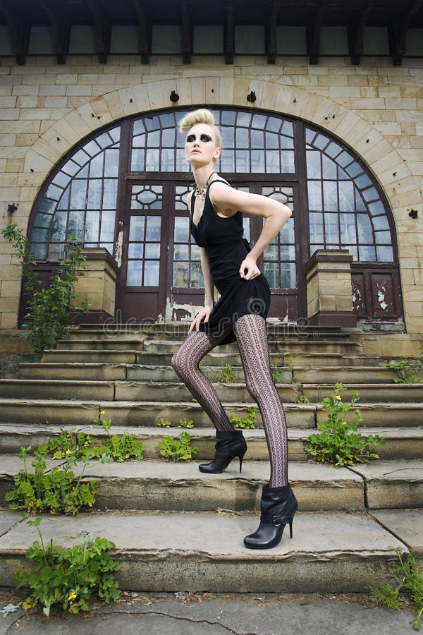Fashion Model In Front Of And Old House Stock Photography