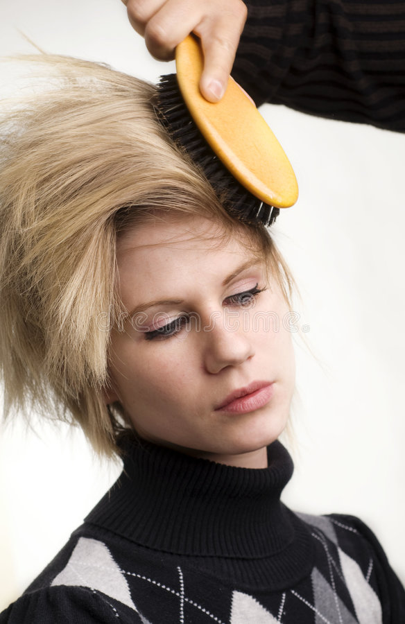 Fashion model getting hair styled royalty free stock image