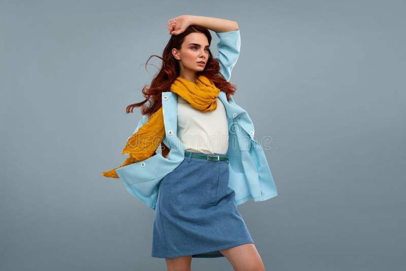 Fashion Model Girl In Beautiful Fashionable Clothes In Studio. Fashion Model Girl In Fashionable Clothes On Grey Background. Beautiful Woman Wearing Stylish stock photography