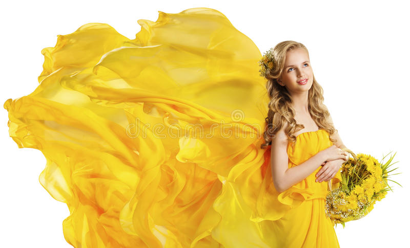 Fashion Model Girl with Flowers Bouquet, Flying Dress Fabric royalty free stock image