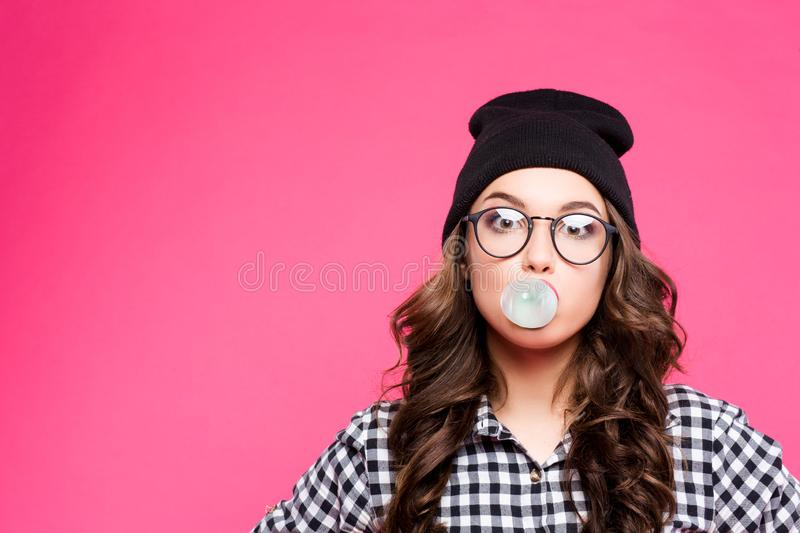 Fashion Model girl isolated over pink background. Beauty stylish woman posing in fashionable clothes and glasses. High. Fashion urban style. inflate the balloon stock photos