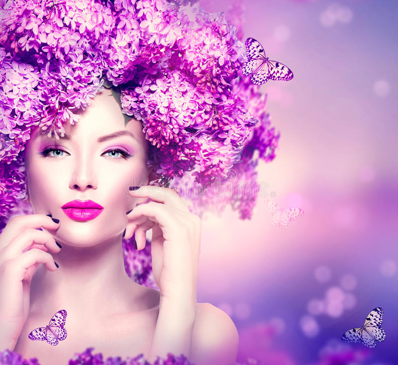 Fashion model girl with lilac flowers hairstyle. Beauty fashion model girl with lilac flowers hairstyle royalty free stock photography