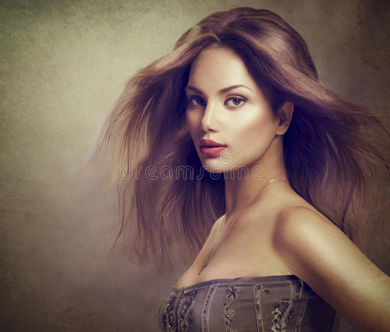 Fashion model girl with long blowing hair stock photography