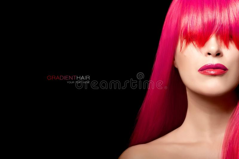Fashion model girl with a long gradient hair. Hair color beauty. Hair color beauty concept. Fashion model girl with a long gradient hair in pink and red colors stock photography
