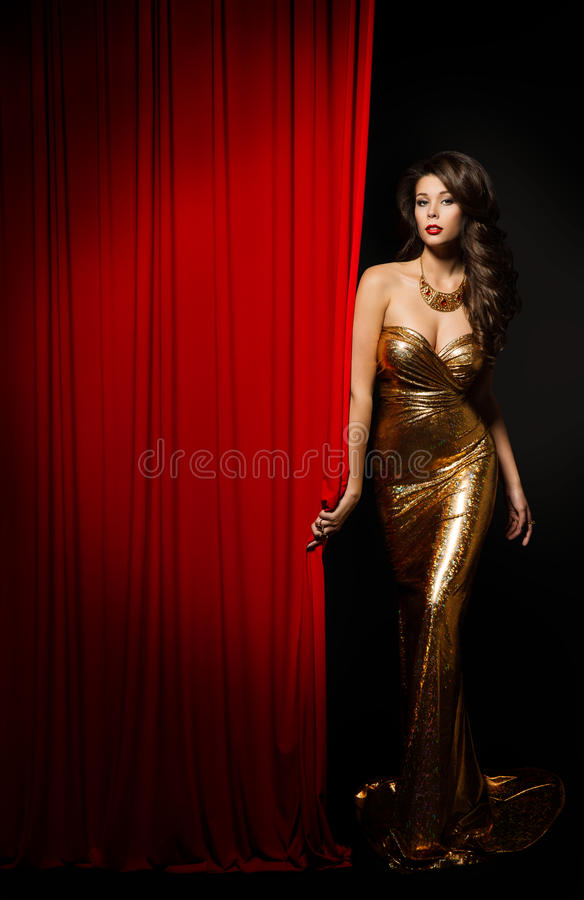 Fashion Model Girl Opening Curtain Stage, Elegant Woman Dress. Fashion Model Girl Opening Red Curtain Stage, Elegant Woman Gold Dress royalty free stock photo