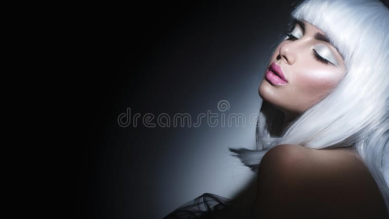 Fashion model girl portrait. Beauty woman with white hair. And beautiful makeup royalty free stock images