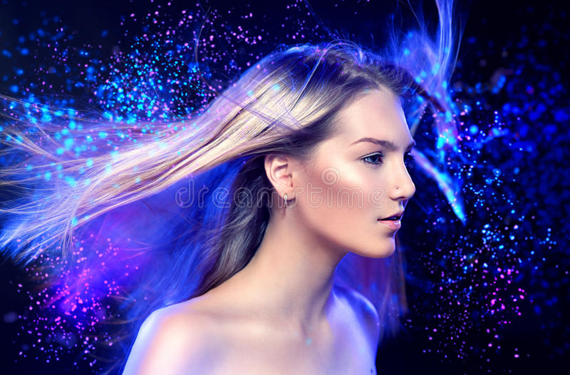 Fashion model girl portrait. With long blowing blond hair stock image