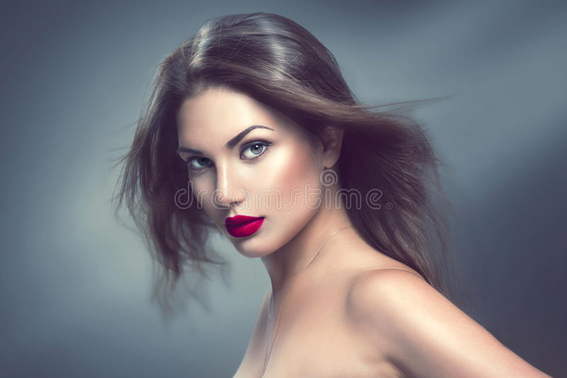 Fashion model girl portrait with long hair. Fashion model girl portrait with long blowing hair royalty free stock photos