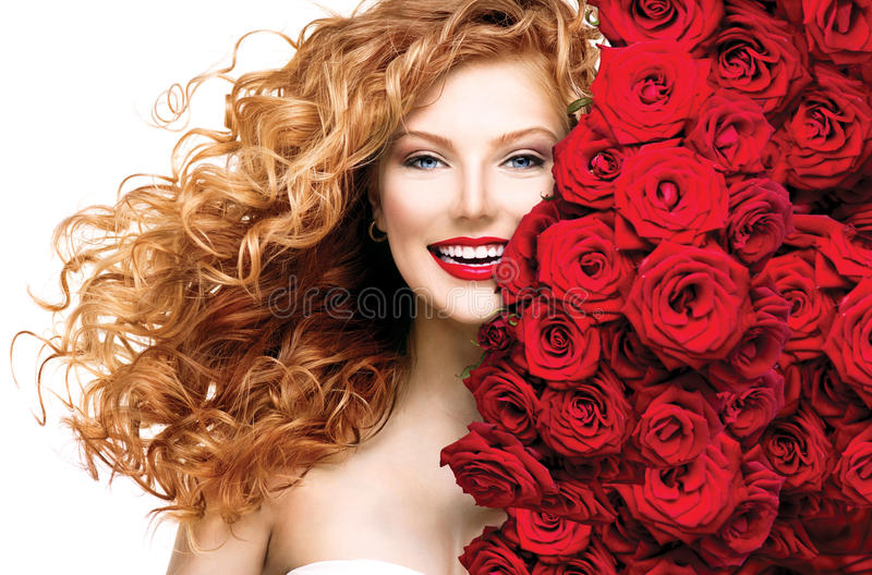 Fashion model girl with red hair. Fashion model girl with blowing red permed hair royalty free stock image