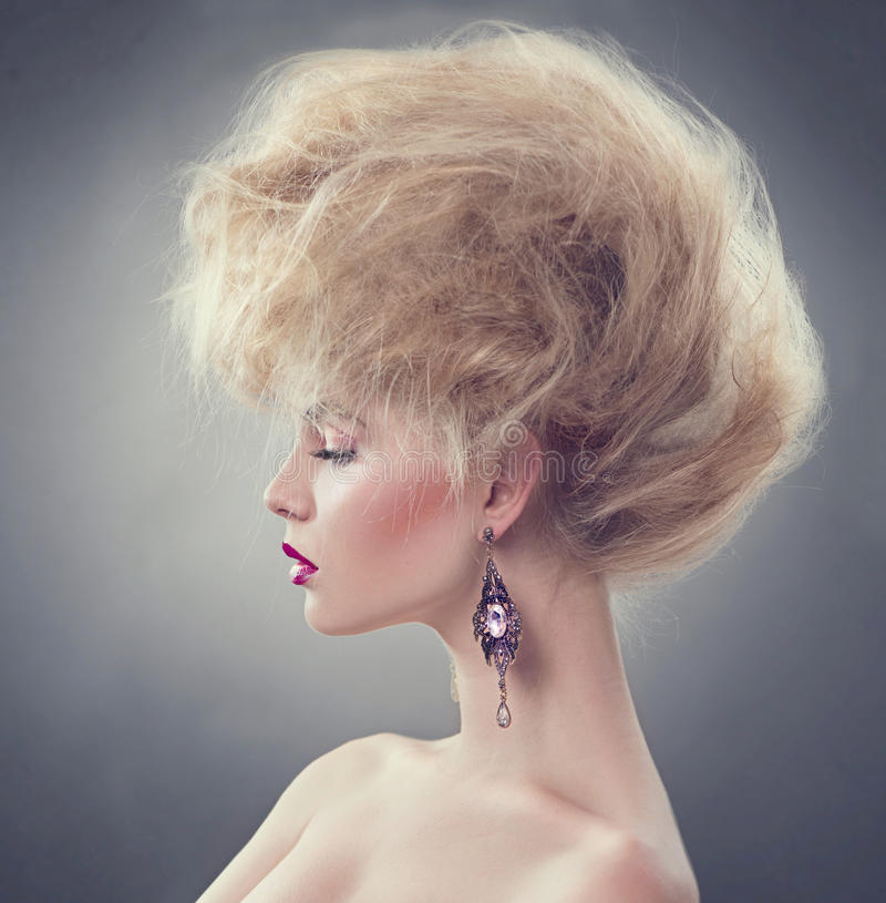 Fashion model girl with updo hairstyle. High fashion model girl with updo hairstyle royalty free stock photos