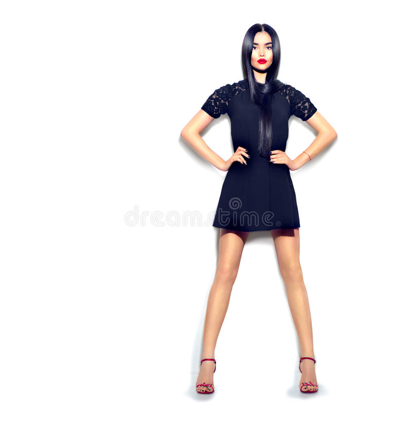Fashion model girl wearing little black dress on white stock photos