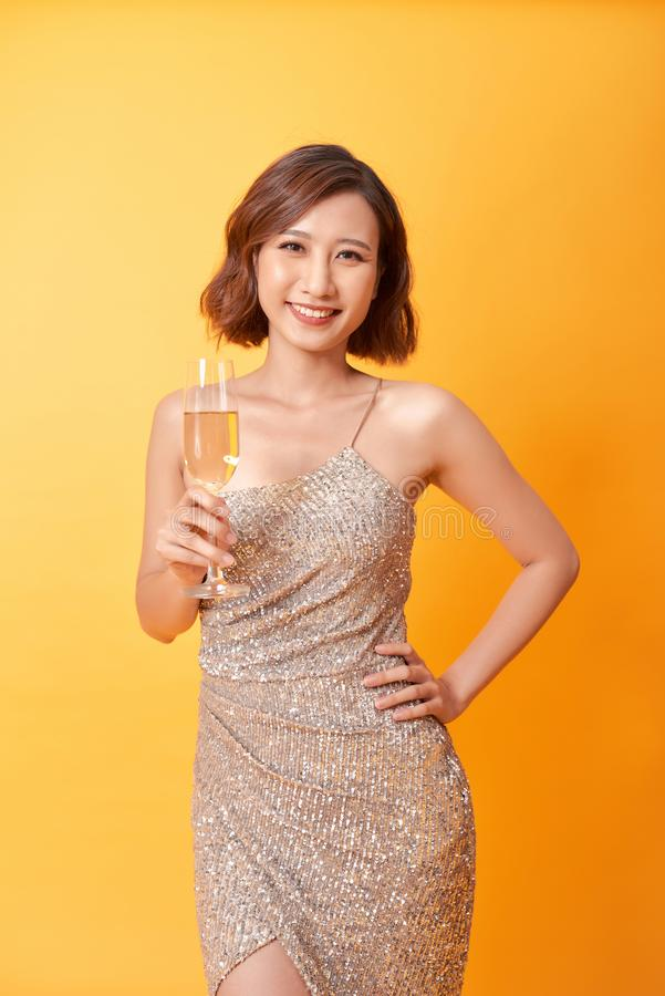 Fashion Model Gold Dress, Woman in Beauty Golden Gown with Champagne, Lady in Long Clothes royalty free stock photography