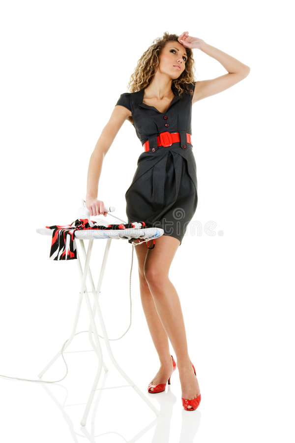 Fashion model iron clothes. Dreaming fashion model iron clothes isolated over white stock photography