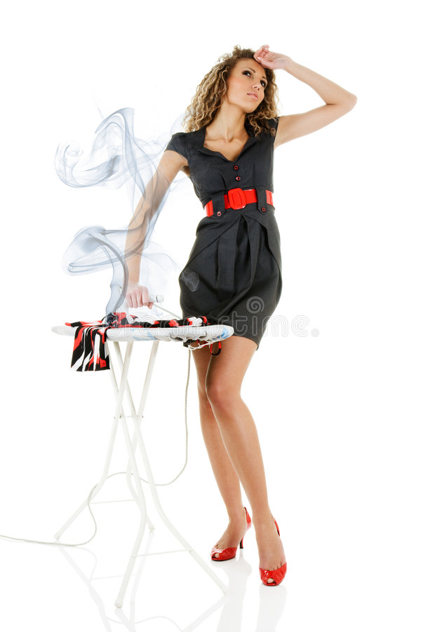 Fashion model iron clothes. Dreaming fashion model iron clothes isolated over white royalty free stock photos