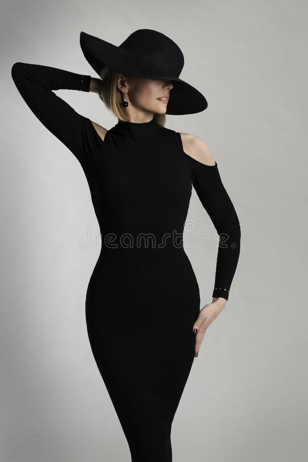 Fashion Model Long Dress, Wide Brimmed Hat, Elegant Lady Beauty. Portrait, Woman Posing on White Studio background royalty free stock photos