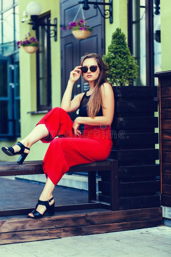 Fashion model with long hair wearing sunglasses stock images