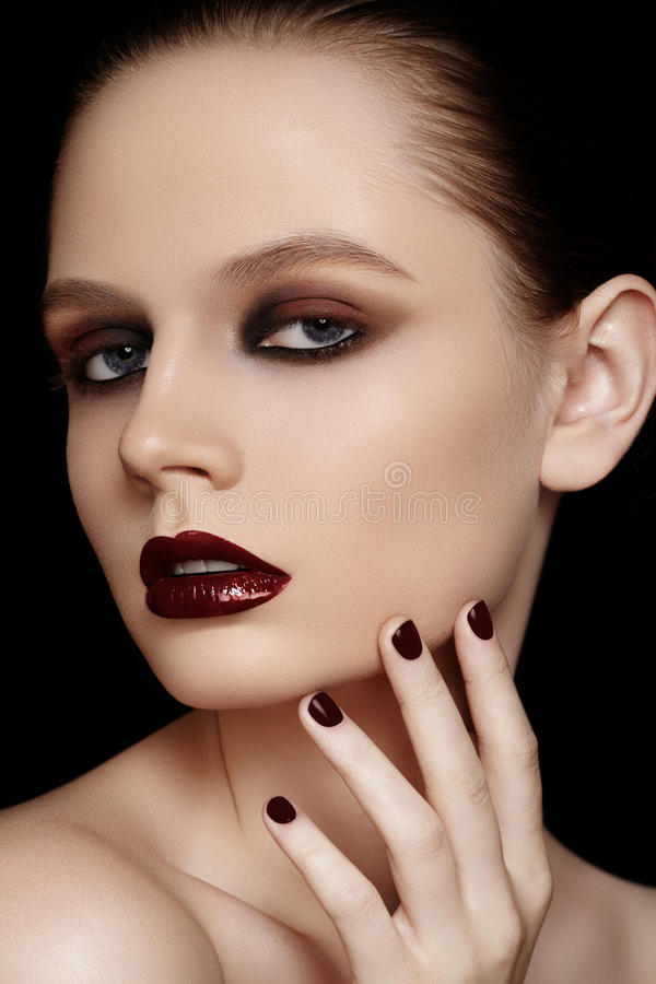 Fashion model with maroon manicure, make-up. High fashion beauty model. Maroon nails, bloody red lips, dark eye makeup & clean skin make-up. Portrait beautiful stock images