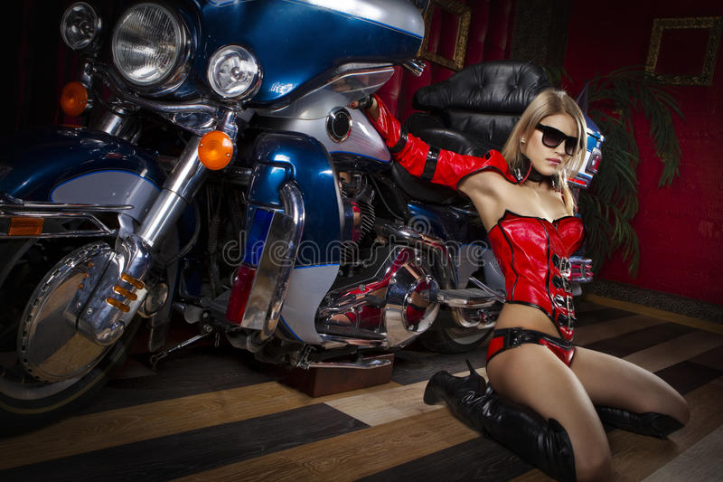 Fashion model with motorbike royalty free stock photos