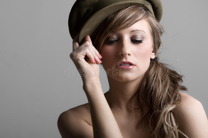 Fashion Model in Old Military Hat. Stunning Shot of a Fashion Model in Old Military Hat royalty free stock images