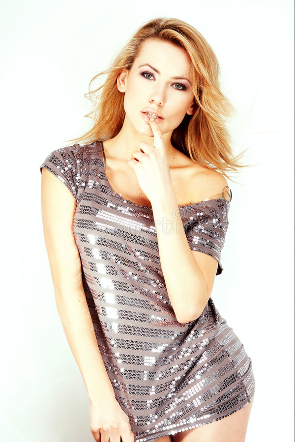 Fashion model Posed on light background. In nice dress stock image