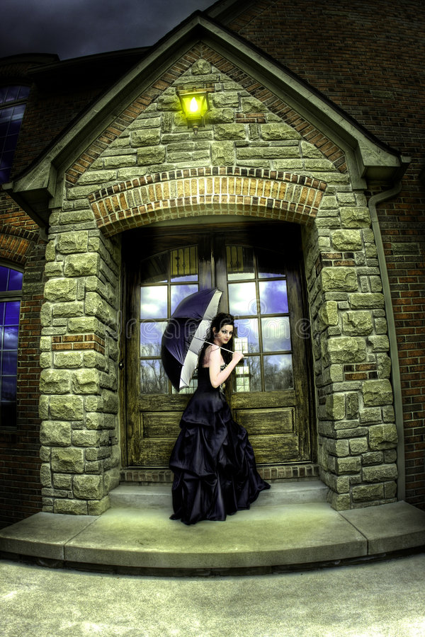 Fashion model posing. Female model in a dark and moody settings royalty free stock image