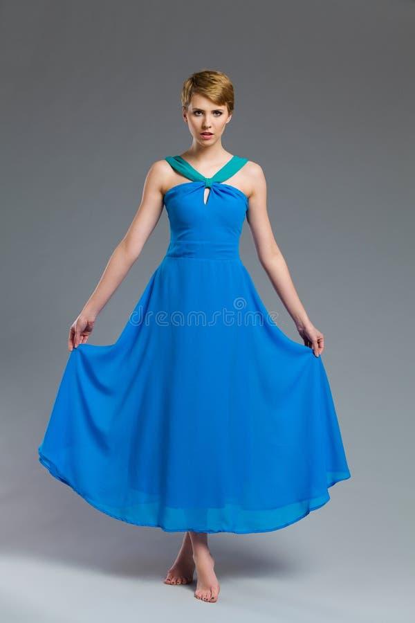 Fashion model posing in blue dress. royalty free stock image