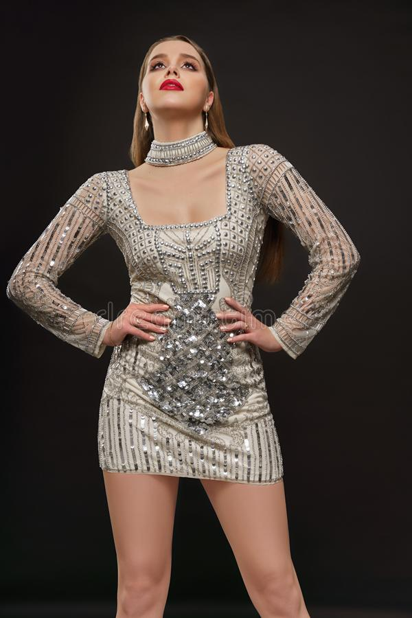 Fashion model posing in elegant beaded dress. royalty free stock photography