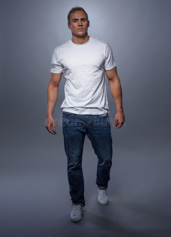 fashion model posing in jeans and white tshirt stock