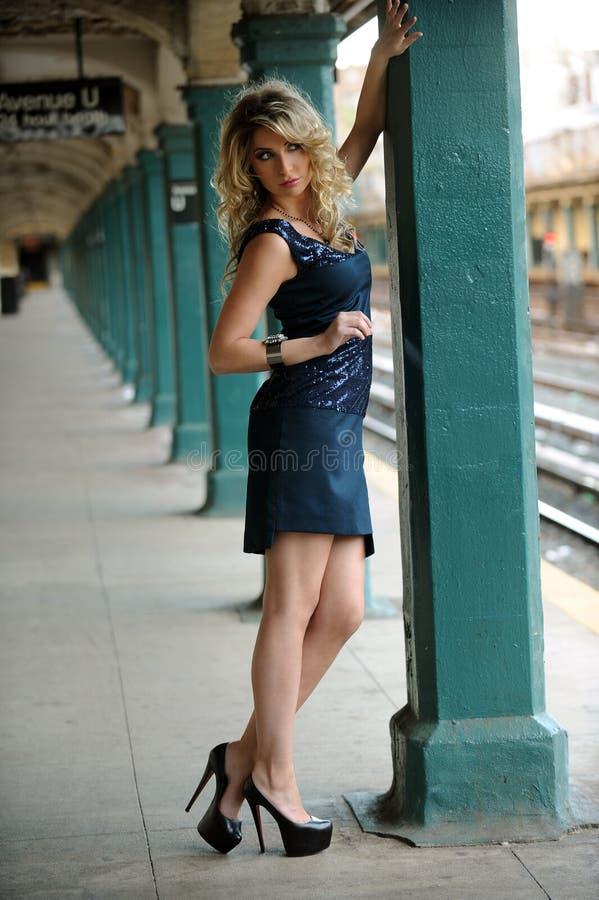 Fashion model posing pretty in NYC subway royalty free stock image