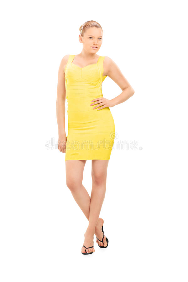 Fashion model posing in a yellow dress stock photos