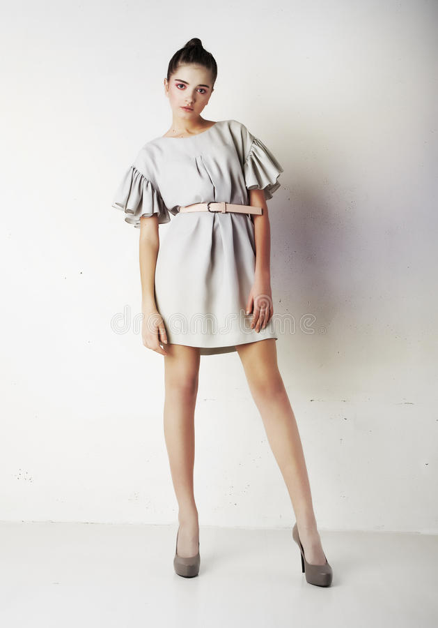 Fashion model pretty woman standing in studio stock photography