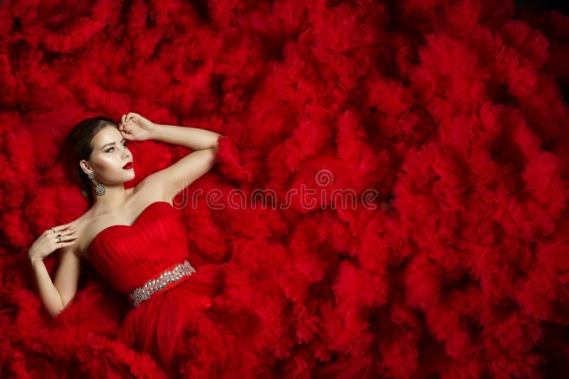 Fashion Model on Red Dress Background, Woman Beauty Portrait royalty free stock photography
