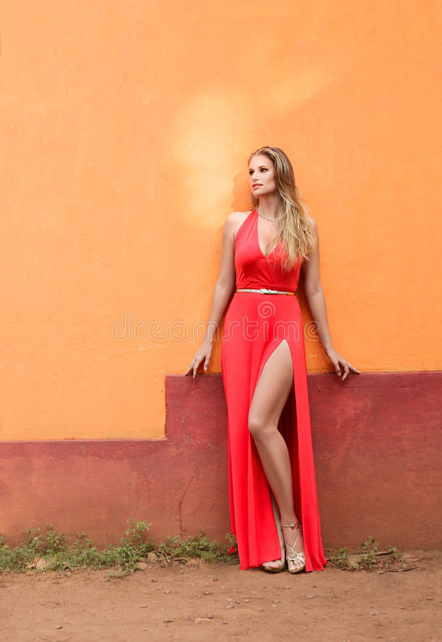Fashion model in a red dress stock photography