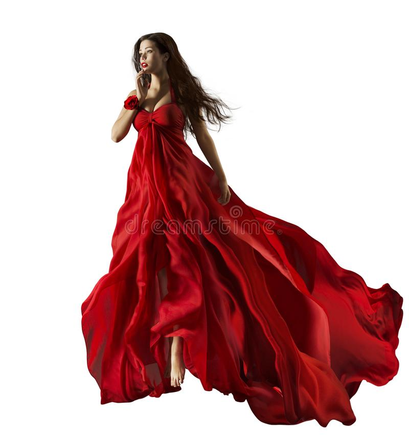 Fashion model in red dress, beautiful woman portrait waving gown royalty free stock photo