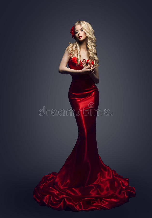 Fashion Model Red Dress, Stylish Woman in Elegant Beauty Gown, G. Irl Posing Slinky Evening Clothes in Studio royalty free stock photo