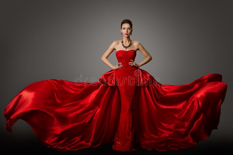 Fashion Model Red Dress, Woman in Long Fluttering Waving Gown, Beauty Portrait stock photography