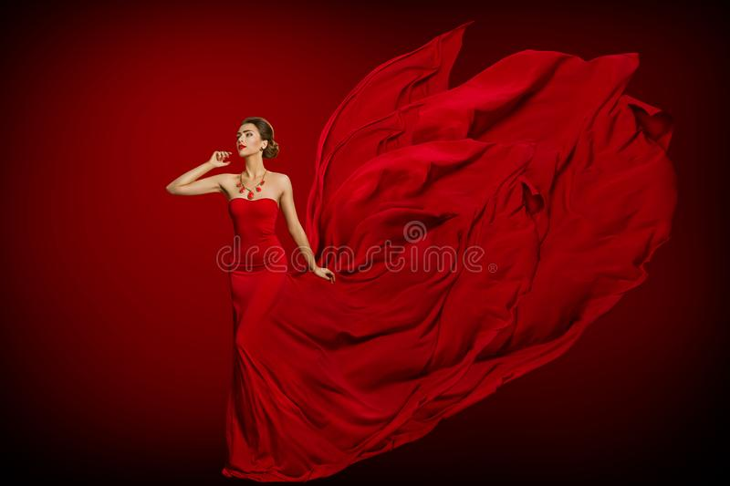 Fashion Model Red Flaming Dress, Woman in Long Fluttering Waving Gown Tail, Young Girl Beauty Portrait. Fashion Model Red Flaming Dress, Woman in Long Fluttering royalty free stock photo
