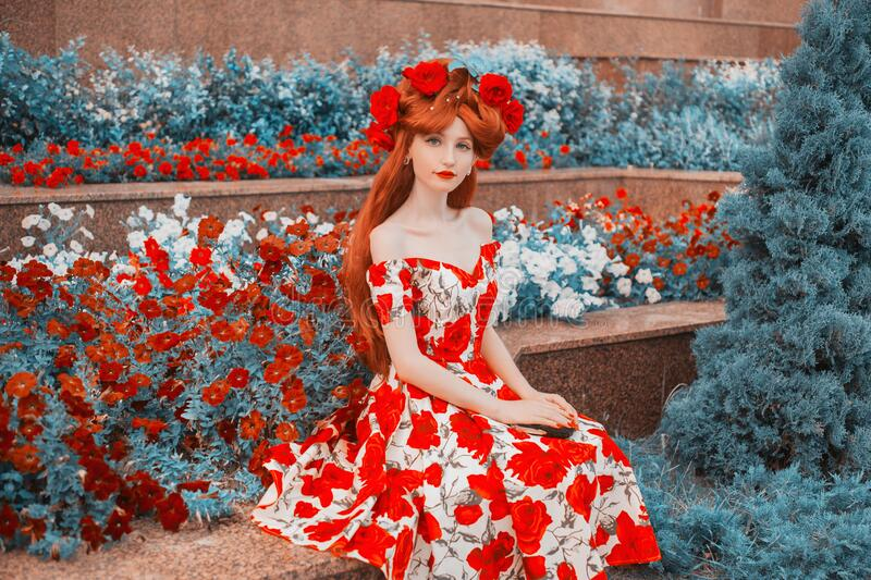 Fashion model with red lips in summer flower dress with rose print on valentine`s background. Model with red nails and rose flowe stock images