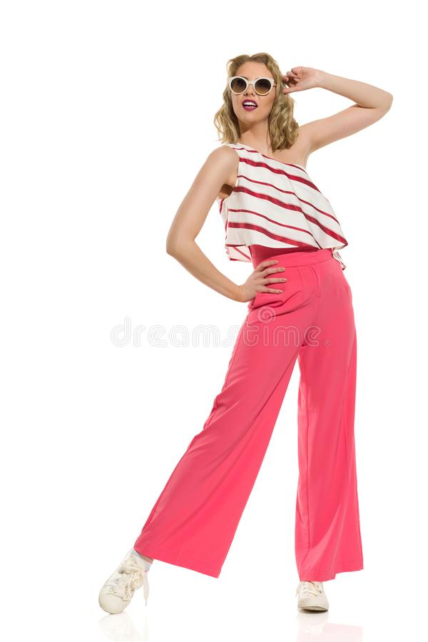 Fashion Model In Red Wide Leg Trousers And Sunglasses stock photography