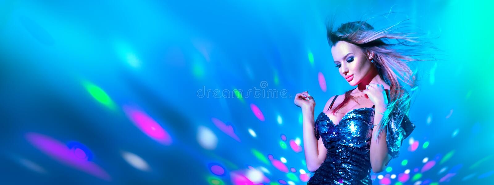 Fashion model sexy woman dancing in neon light. Disco dancer posing in UV colorful light. S royalty free stock image