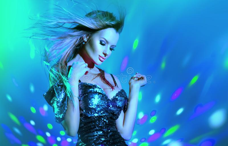 Fashion model sexy woman dancing in neon light. Disco dancer posing in UV colorful light stock photos